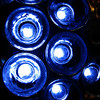 01/04/10 - Circles in Blue<br /> I went with the boys to Home Depot yesterday to buy suet.  Johnny has a thing when we go there that he insists on taking a tour of the lights, fans, sinks, and tubs:-)  Seriously, it's important to him.  That turned into me taking a few pictures of lights.  One of the clerks did come over, but he was friendly vs. in the 'put your camera away' mode.  I thought this was the coolest LED light!  So did the boys.  It's a circular light with chrome in the center, a tabletop model, and a whopping $40.  OK, it's pretty but it's not THAT pretty.  I took several macro shots and then walked away...<br /> <br /> I see I've posted a POTD with circles 3 days straight now.  That wasn't a plan.  We'll see what tomorrow brings.  <br /> <br /> Johnny is much better after being on the antibiotic for 2 days.  I'm glad because that ear infection was very painful.  I will start off the new work year going to the doc myself.  I had hoped to avoid that, but after 10 days my throat is still very sore, so I'm going to force myself to go.  Thanks for your well wishes for both of us.  <br /> <br /> And, thank you for your comments on yesterday's POTD.  The boys always enjoy helping me take a shot and seeing that you guys have to say about the shots.  As a matter of fact, I now have another bottle of sparkling juice...Joey insists that we do that bubble POTD again:-)  I got red grape this time.  We'll see what that means.<br /> <br /> Getting up when it's dark outside by some loud alarm clock is just cruel!<br /> <br /> HAGD,<br /> Maryann