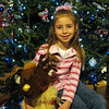 "12/17/09 - Pretty Girl<br /> Hint, if you're a kid and you come to visit my house in December, you're probably going to get your picture taken;-)  Madi dropped by for a few minutes last night, and I made an attempt to get a good Christmas 2009 picture of her.  Madi is 6.<br /> <br /> The rest of the reindeer story...  A few of you have already stumbled across this collage that I did:<br />  <a href=""http://fotomom.smugmug.com/Nature/December-2009/10503706_iqUUs#741305550_AL6Rr"">http://fotomom.smugmug.com/Nature/December-2009/10503706_iqUUs#741305550_AL6Rr</a><br /> There are 7 pictures there of Madi that I took...one for each year of her life at Christmas.  When she was 14 months old, I decided that we needed to have a super cute Christmas picture of her.  I think her mom, Christine, had the red dress and hat.  I went out and bought the reindeer at KM and a large piece of green fabric at Joanne's.  We set up in front of her gas log fireplace at her house, and I worked to get the best shot that I could.  I think that picture was taken with my 2MP Kodak that I had at the time.  Anyway, the other night made me think of the reindeer which made me rememer Madi's one year photo shoot which led to me digging up every Christmas picture I ever took of her and pulling out what I thought was the best one of each year.  I've printed a copy of the collage for her mom and her grandparents.  <br /> <br /> Thank you all very much for your comments on the barn shot from yesterday.  I'm glad some of you thought the Coffee Shop link was worthwhile.  I sure have.  <br /> <br /> HAGD,<br /> Maryann"